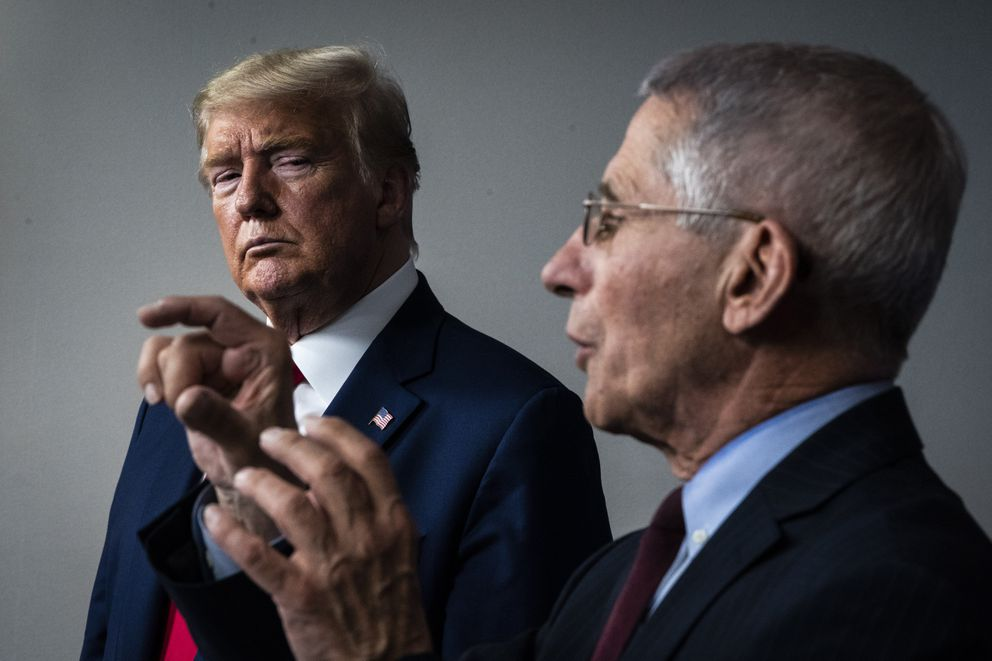 President Donald Trump listens as Dr. Anthony Fauci speaks with members of the coronavirus task force in March. (Washington Post photo by Jabin Botsford)