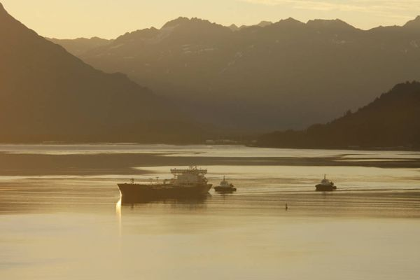 An oil tanker is seen under tug escort at the Valdez Marine Terminal. More foreign-flagged vessels are traversing Alaska waters since last year as depressed West Coast demand has increased sailings to overseas ports, mostly China, since last May. (Photo by Alyeska Pipeline Service Co.)