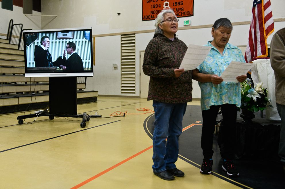 Mike Dunleavy is sworn in as Alaska's governor while Noorvik elders sing. A broadcast of Mike Dunleavy's inauguration was shown at the Noorvik School, where the event was supposed to be held before weather changed the plan, on December 3, 2018. (Marc Lester / ADN)