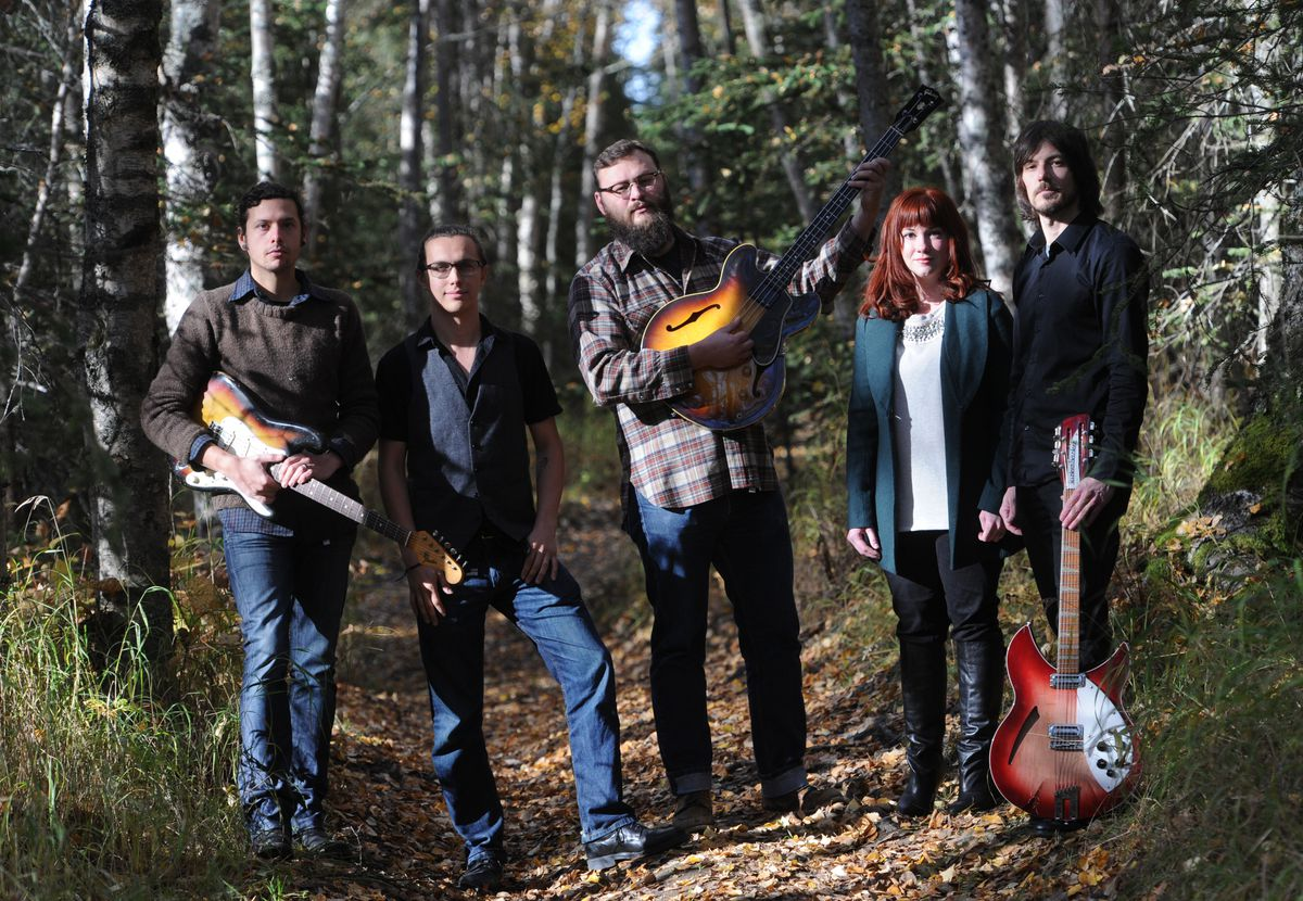 Local rock and roll band The Modern Savage, from left, Matt Eley guitar, keyboards, and vocals; drummer David Devlin; Ivan Molesky, bass; Jenni May Toro, lead vocals; John Cripps guitar and keyboards on Sunday, Sept. 28, 2014. The band will perform in Anchorage this week for the first time since May. (Bill Roth / ADN)
