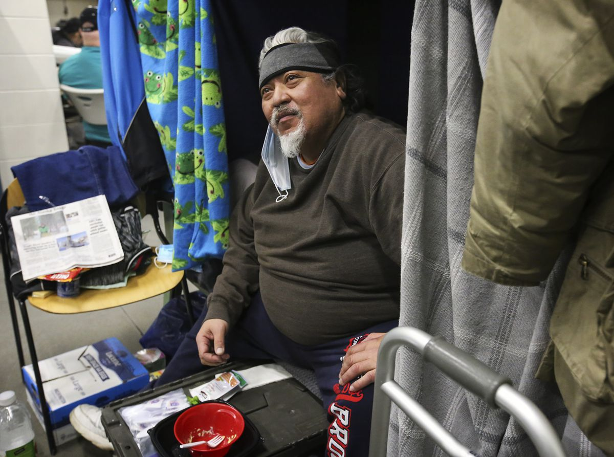 Michael Meisake in his bunk at the Brother Francis Shelter in Anchorage on March 9, 2021. Meisake received his second dose of the COVID-19 vaccine Tuesday. (Emily Mesner / ADN)