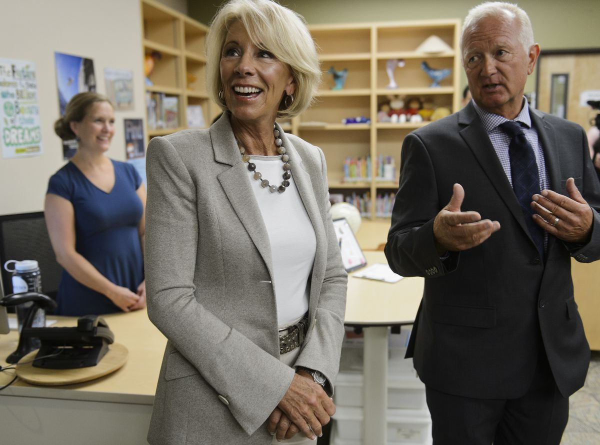 U.S. Secretary of Education Betsy DeVos gets a tour of Mat-Su Central School by principal John Brown, right, on August 26, 2019. (Marc Lester / ADN)