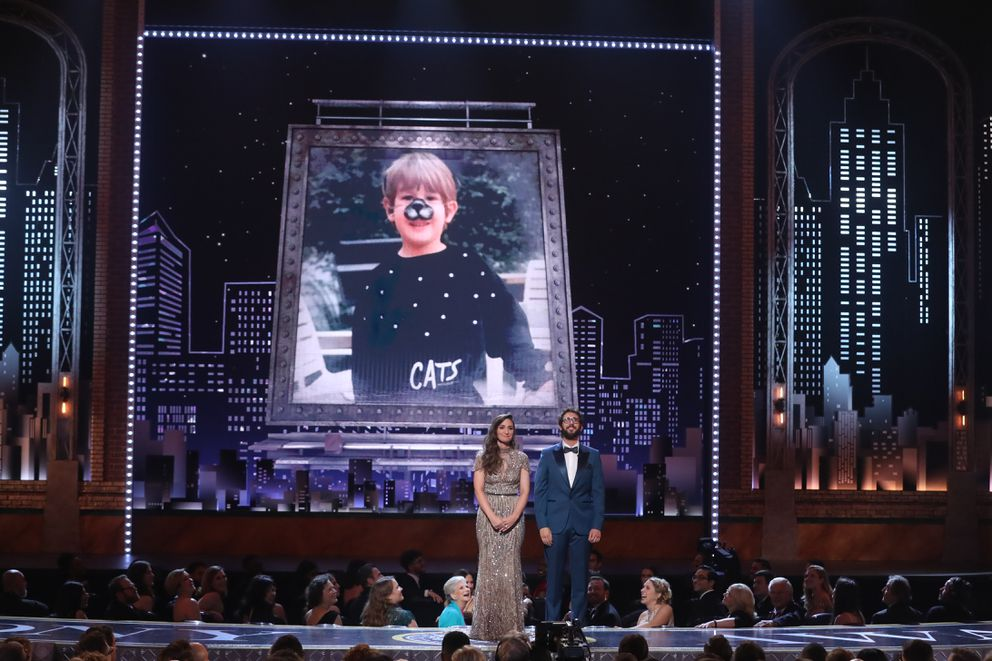Sara Bareilles and Josh Groban host in front of a childhood photo of Groban at the 72nd Annual Tony Awards at Radio City Music Hall in New York, June 10, 2018. (Sara Krulwich/The New York Times)