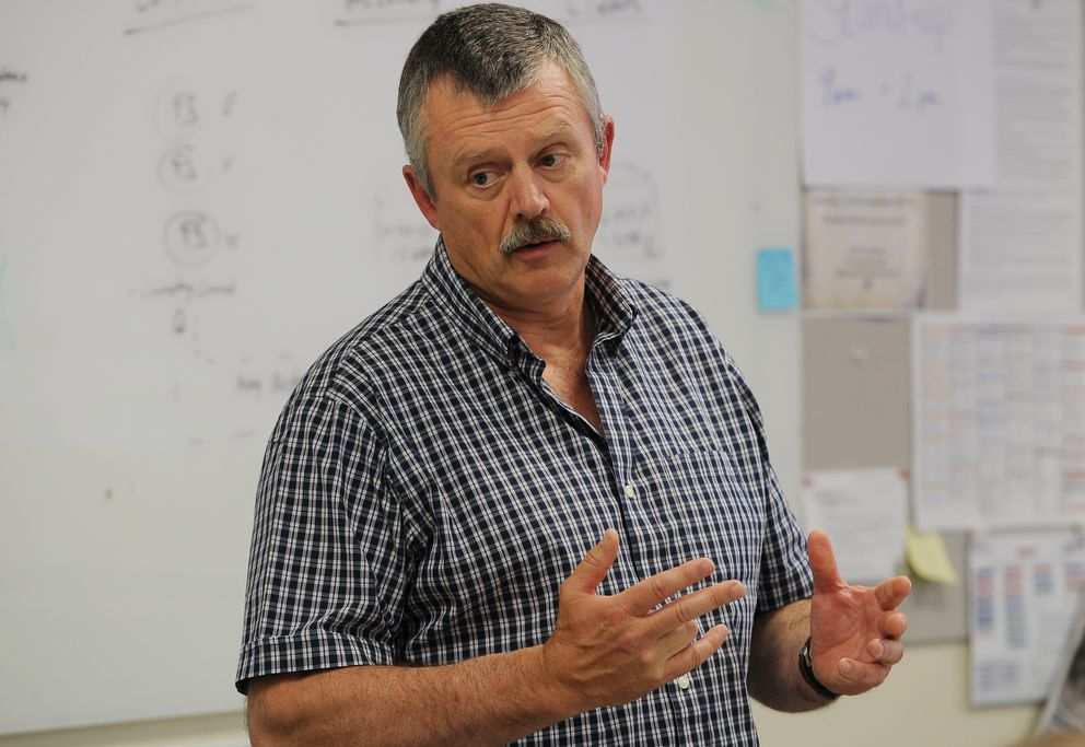 Mat-Su Borough IT director Eric Wyatt leads a meeting in Palmer on Monday, July 30. 2018, and gets status updates from IT teams working on remedies after the cyber attack. (Bill Roth / ADN)