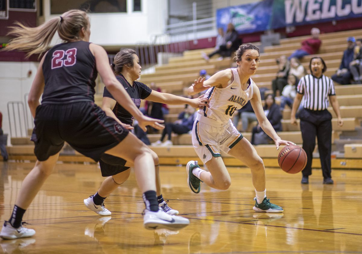 UAA senior guard Yazmeen Goo drives around the Central Washington defense during a GNAC tournament semifinal game earlier this month in Seattle. (Photo by Matt Brashears)