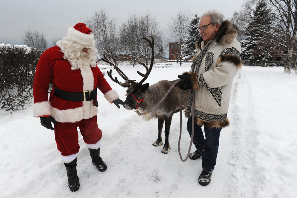 Santa Claus take a look at Star the Reindeer with his owner Albert Whitehead. (Bill Roth / ADN)