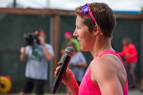 Kikkan Randall speaks to the crowd before the Alaska Run For Women Saturday, June 8, 2019 in Anchorage. Randall, an Olympic gold medalist, 3-time Alaska Run For Women overall winner, and breast cancer survivor, set a new survivor record Saturday with a time of 29:29 on the 5-mile race. (Loren Holmes / ADN)
