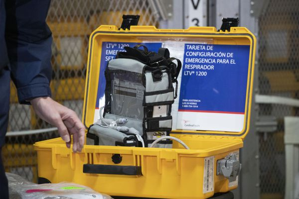 A ventilator is displayed during a news conference, Tuesday, March 24, 2020 at the New York City Emergency Management Warehouse, where 400 ventilators have arrived and will be distributed. Gov. Andrew Cuomo has sounded his most dire warning about the coronavirus pandemic on Tuesday, saying the infection rate in New York is accelerating and the state could be two to three weeks away from a crisis. (AP Photo/Mark Lennihan)