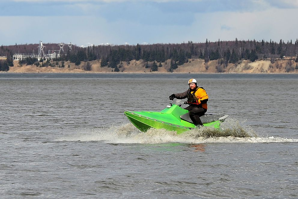 Brian McKinnon of Mackinnon Marine Technologies brings his AlumaSki personal watercraft in to shore on April 17, 2015, at Point Woronzof near Anchorage. He had brought the craft out for testing by members of the Ted Stevens Anchorage International Airport Police and Fire Department. (Erik Hill / ADN archive 2015)