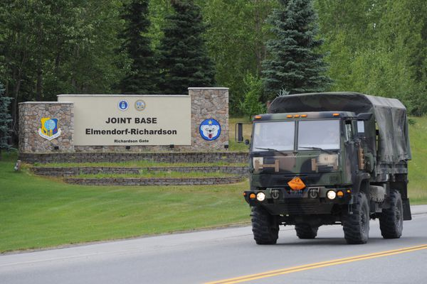 A military vehicle exits the Fort Richardson gate on Wednesday, July 8, 2015. According to Alaska's congressional delegation, the U.S. Army plans to cut 2,600 troops at Joint Base Elmendorf-Richardson in Anchorage. (Bill Roth / Alaska Dispatch News)