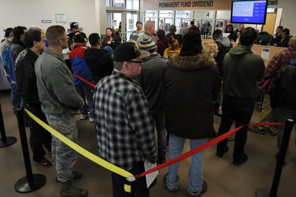 People wait for assistance filing for the PFD inside the PFD office in downtown Anchorage on Wednesday, March 28, 2018. Friday is the last day to get in-person help filing PFD applications and Saturday is the deadline to file for the PFD online. (Bill Roth / ADN)
