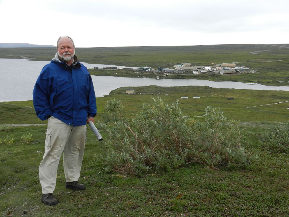Ed Rastetter stands on a small hill overlooking Toolik Field Station. (Kelsey Lindsey / Alaska Dispatch News)