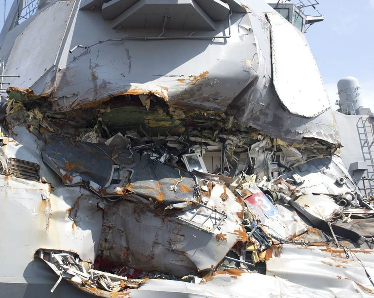 In an undated handout photo, damage to the USS Fitzgerald after it collided with a cargo ship near Japan in June 2017. The collision, and that of another American destroyer near Singapore, was the result of a string of avoidable crew and navigational errors, the Navy said in reports made public on Nov. 1, 2017. (U.S. Navy via The New York Times)