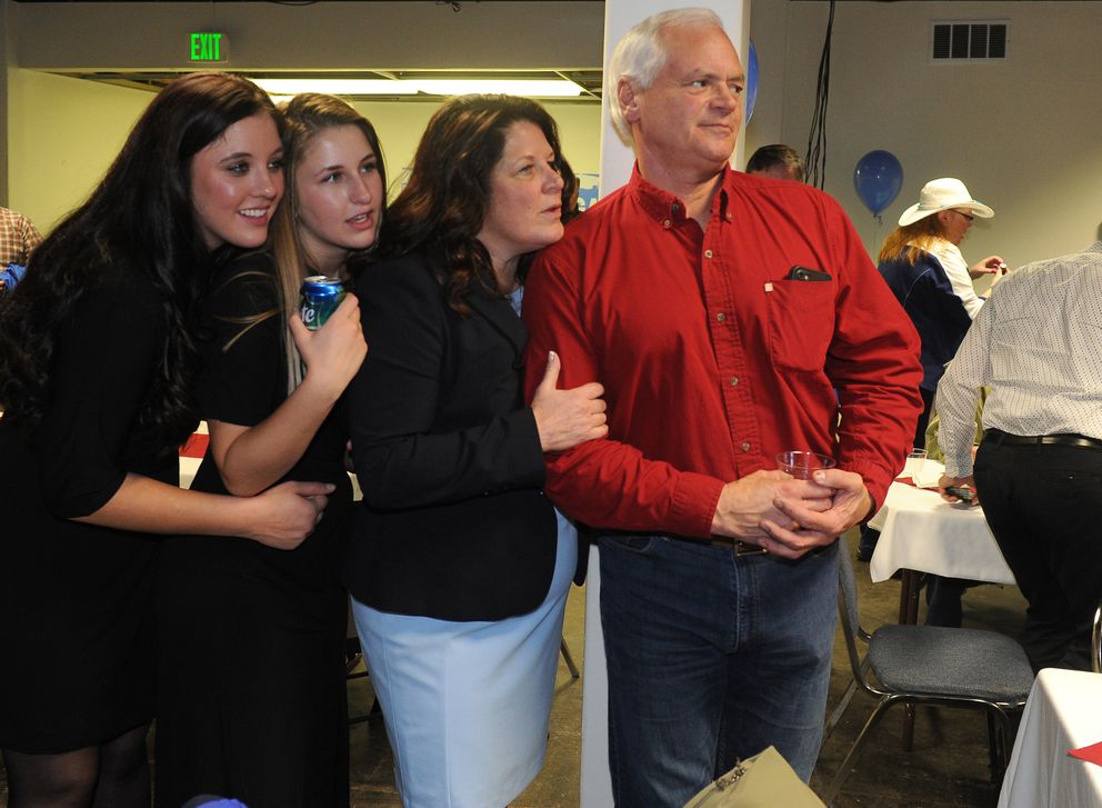 Daughters Lindsey Logan and Lauren Logan and Anchorage mayoral candidate Rebecca Logan along with Rebecca's fiancée Scott Harter wait for election results at her headquarters on 5th Ave in Anchorage, AK on Tuesday, April 3, 2018. (Bob Hallinen / ADN)