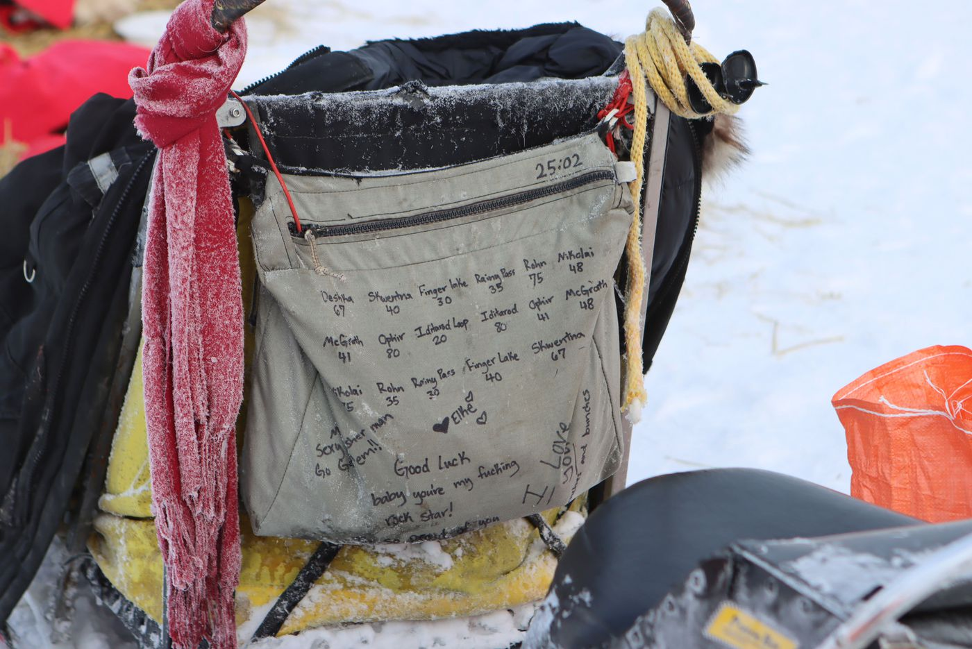 Matt Hall's sled bag is covered with writing, including encouraging notes from family and the mileage between checkpoints along the route. Photographed in McGrath on Wednesday March 10th. (Zachariah Hughes/for ADN)
