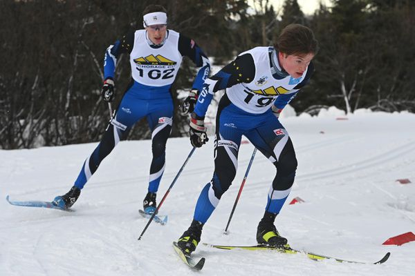 Olympian Tyler Kornfield, left, and Kai Meyers round a corner while competing in the 25K classic race during the AMH Anchorage Cup race #3 at Kincaid Park on Sunday, Jan. 24, 2021. Kornfield placed third and Meyers took second behind winner Thomas O'Harra. (Bill Roth / ADN)