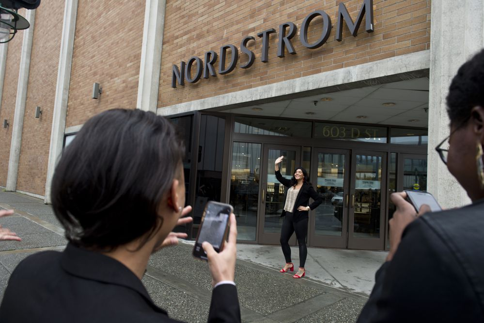 Nordstrom employee Jackalynne Smith is photographed near the store's front entrance on it's last day of business. Nordstrom department store closed permanently in downtown Anchorage on September 13, 2019. (Marc Lester / ADN)