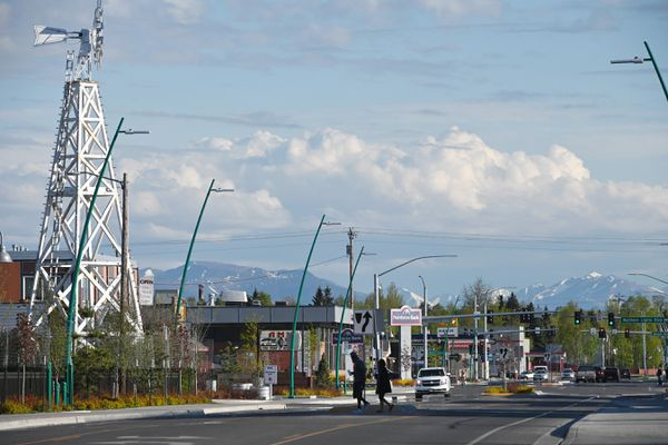 Pedestrians cross Spenard Road in this view looking South towards Northern Lights Boulevard on Sunday, May 17, 2020. (Bill Roth / ADN)
