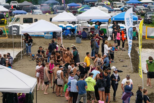 People socialize at the Big Lake Lions 33rd annual mud volleyball tournament on Saturday, July 25, 2020 in Big Lake. The games drew over 500 people to the day-long event, which was a fundraiser for Big Lake Lions Club. (Loren Holmes / ADN)