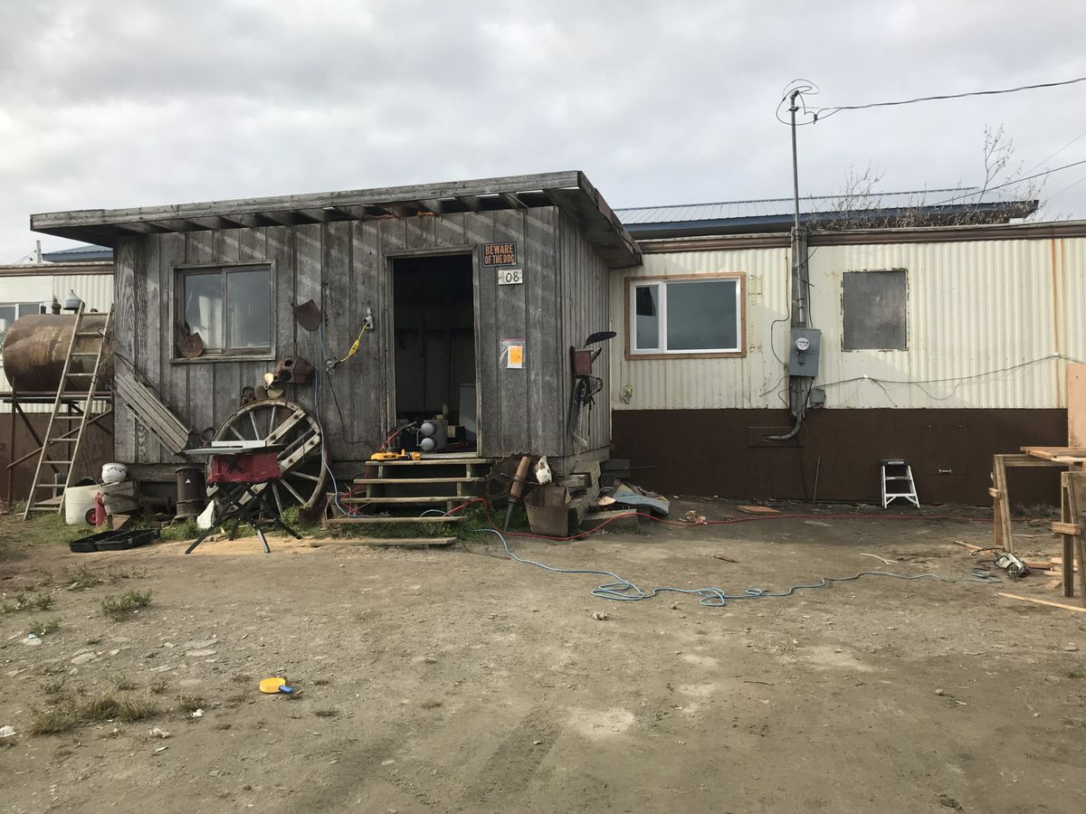Windows and skirting were recently in the process of being replaced on this house in Nome. (Emily Hofstaedter, KNOM)
