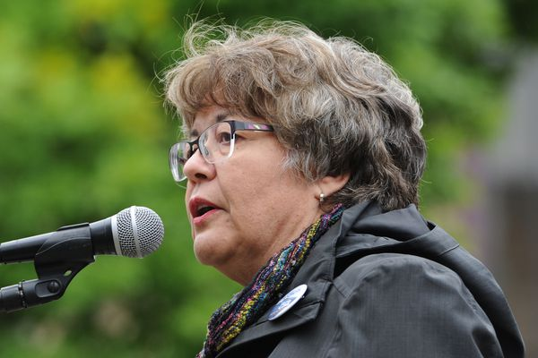 Debra Call who is running for Lt. Gov. with Mark Begich speaks to activists gathered at Peratrovich Park in downtown Anchorage on Women's Equality Day, Sunday, August 26, 2018, urging Alaska Sens. Lisa Murkowski and Dan Sullivan to vote no on Pres. Donald Trump's Supreme Court nominee Brett Kavanaugh. (Bill Roth / ADN)