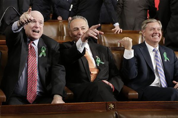 From left, Sen. John McCain, R-Ariz., Sen. Charles Schumer, D-N.Y. and Sen. Lindsey Graham, R-S.C. sit on Capitol Hill in Washington, Tuesday, Feb. 12, 2013, before President Barack Obama's State of the Union address during a joint session of Congress.