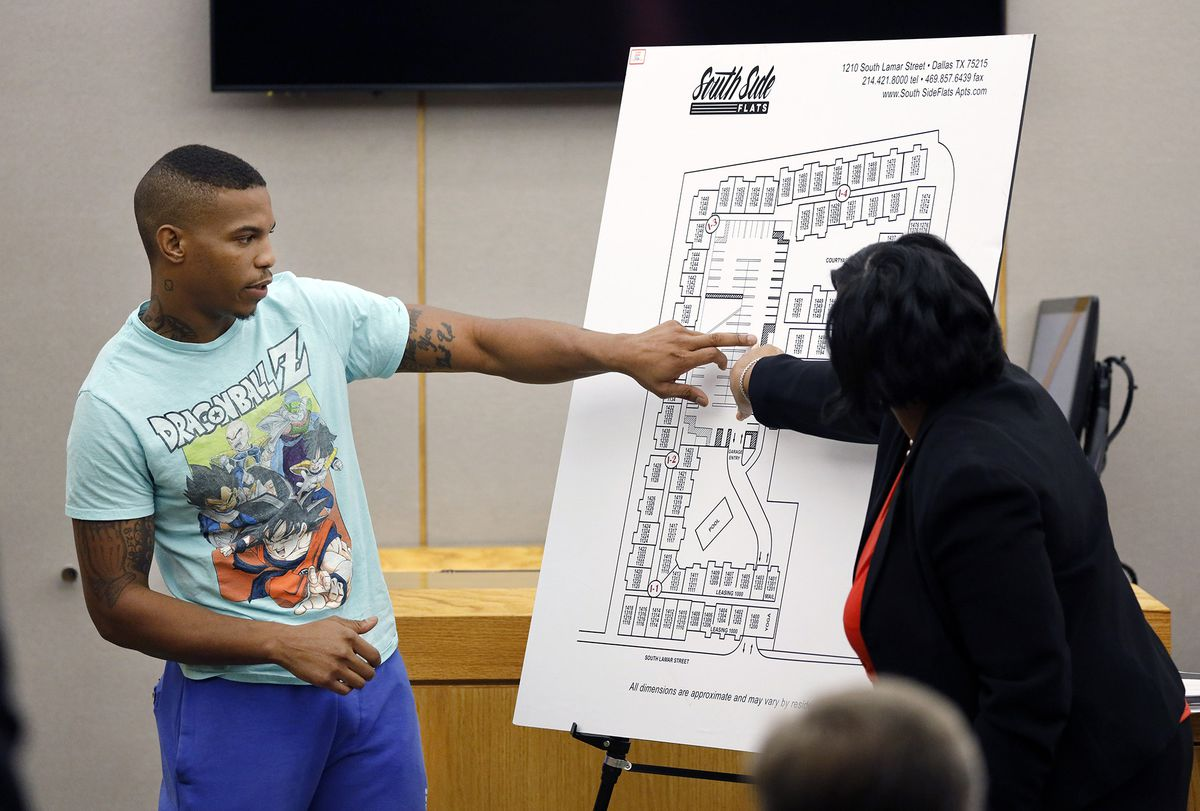 Answering Assistant District Attorney LaQuita Long's question (right), Botham Jean's neighbor, Joshua Brown (left) points to a map of the South Side Flats where he lives. He lived across the hall from Botham Jean. (Tom Fox/The Dallas Morning News)