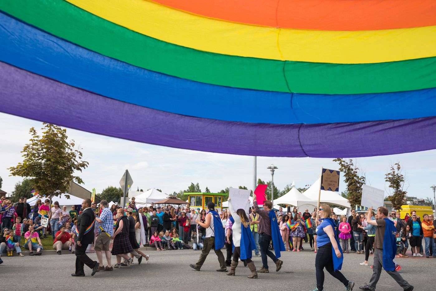 Participants walk in the Alaska Pride equality parade Saturday, June 24, 2017. Identity Alaska, a statewide LGBT organization, has organized a pride festival each year since its founding in 1977. (Loren Holmes / Alaska Dispatch News)