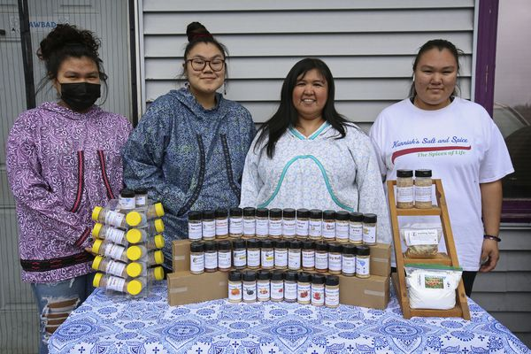 From left, Kallista, Courtney, Kunniak and Deanna Hopson stand behind a display of spices and seasonings from Kunniak's Spices in Chugiak on Thursday, April 29, 2021. (Emily Mesner / ADN)