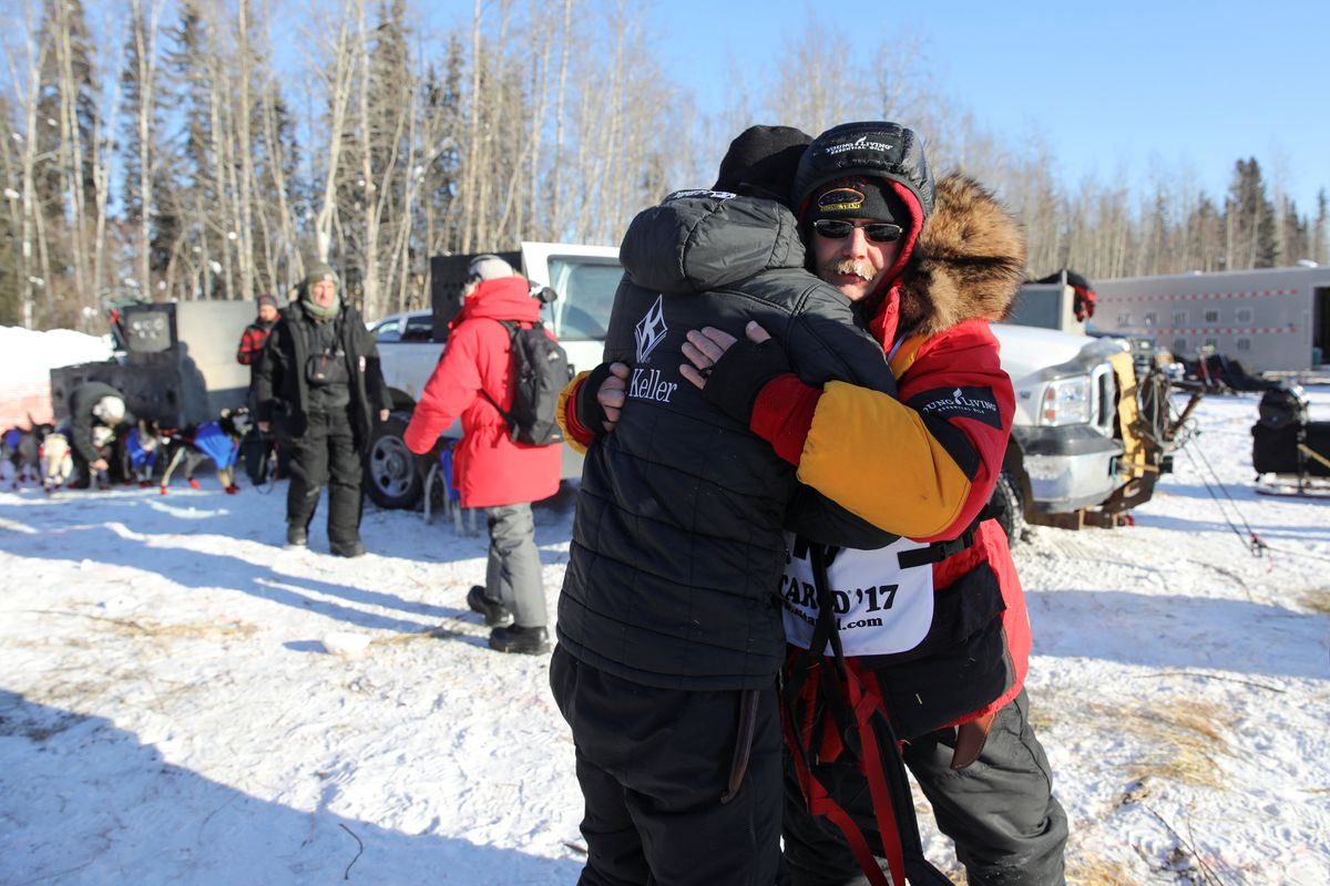 Two-time champion Mitch Seavey hugs his son Dallas Seavey (a four-time champion) before they both race at the official restart of the 2017 Iditarod Trail Sled Dog Race in Fairbanks on March 6. (Nathaniel Wilder / Reuters)