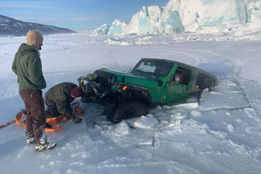 Scott Rees hooks a tow rope up to Josh Tills' Jeep after it sunk near the Knik Glacier on Jan. 26, 2020. (Photo provided by Scott Rees)