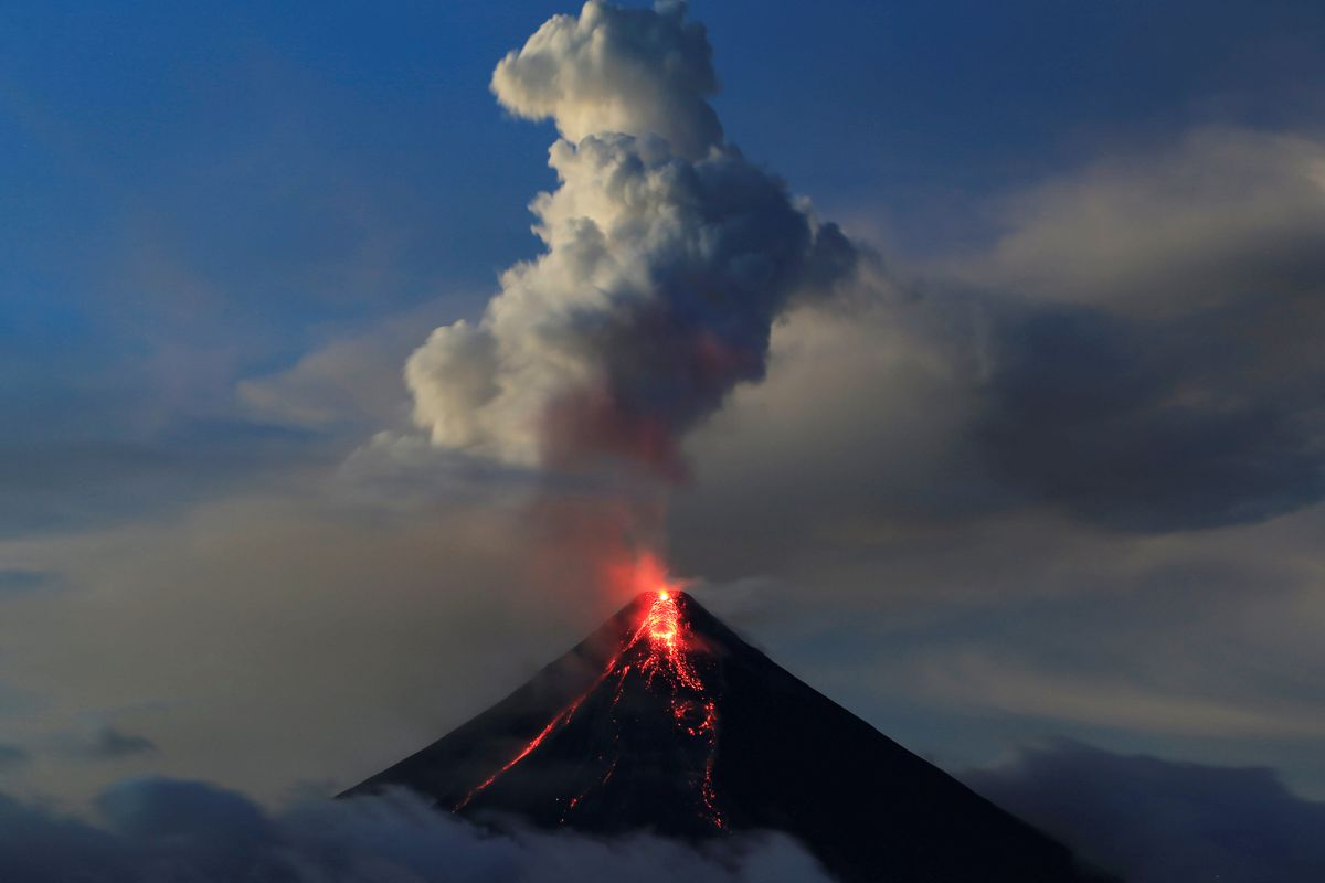 Lava flows from the crater of Mount Mayon volcano in the Philippines during a new eruption Thursday. REUTERS/Romeo Ranoco