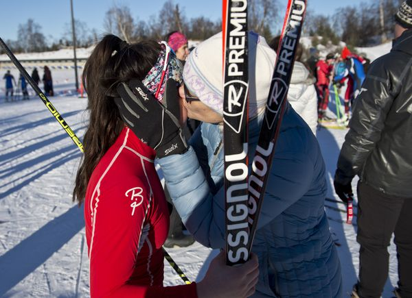 Grace Miller gets a kiss from her mother, Kymberly Miller, after a Besh Cup race at Kincaid Park. Kymberly adopted Grace from China in 2003. (Marc Lester / ADN)