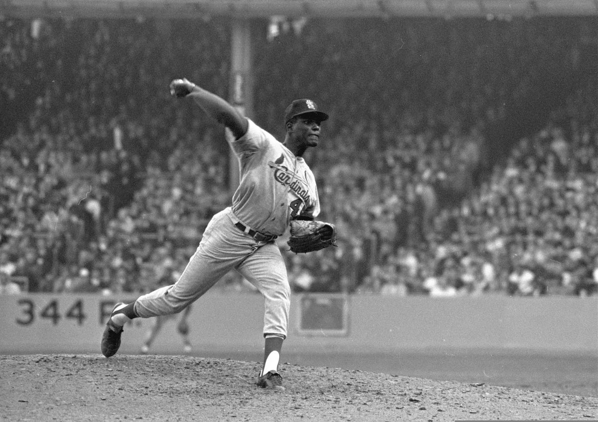 FILE - In this Oct. 12, 1964, file photo, St. Louis Cardinals pitcher Bob Gibson throws to a New York Yankees batter during Game 5 of the World Series, in New York. (AP Photo, File)