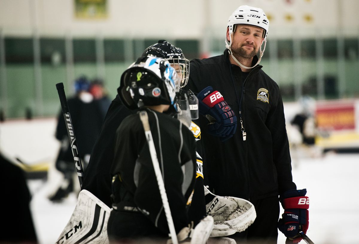 Steve Thompson, who is leaving Alaska in August to become USA Hockey's goaltending manager, works with goalies at his Alaska Goaltending Academy camp at the Wells Fargo Sports Complex. (Marc Lester / ADN)