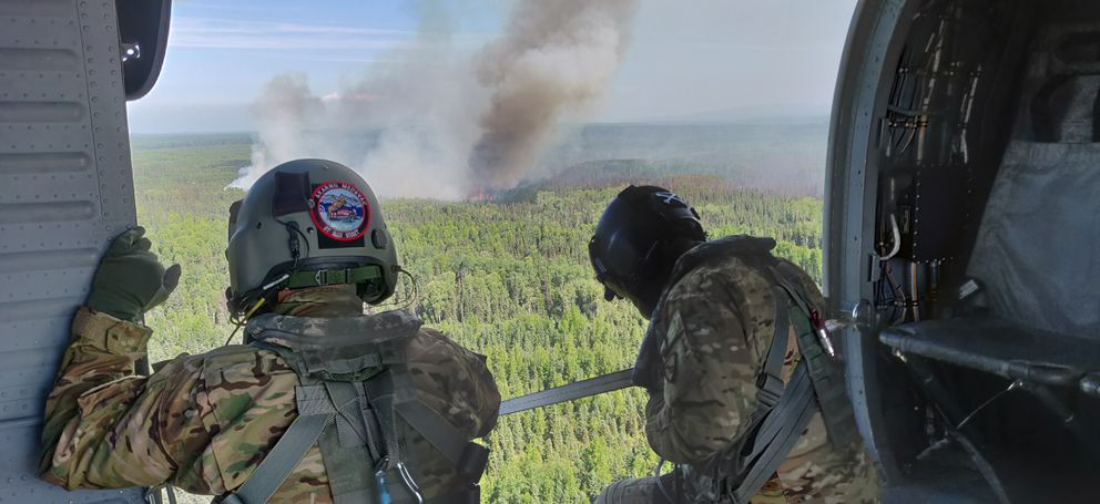 Two Alaska Army National Guard Black Hawk helicopters and aircrew from 1st Battalion, 207th Aviation perform Bambi bucket water drops over the Montana Creek Fire, July, 4, 21019. (Photo by SPC. Michael Risinger)