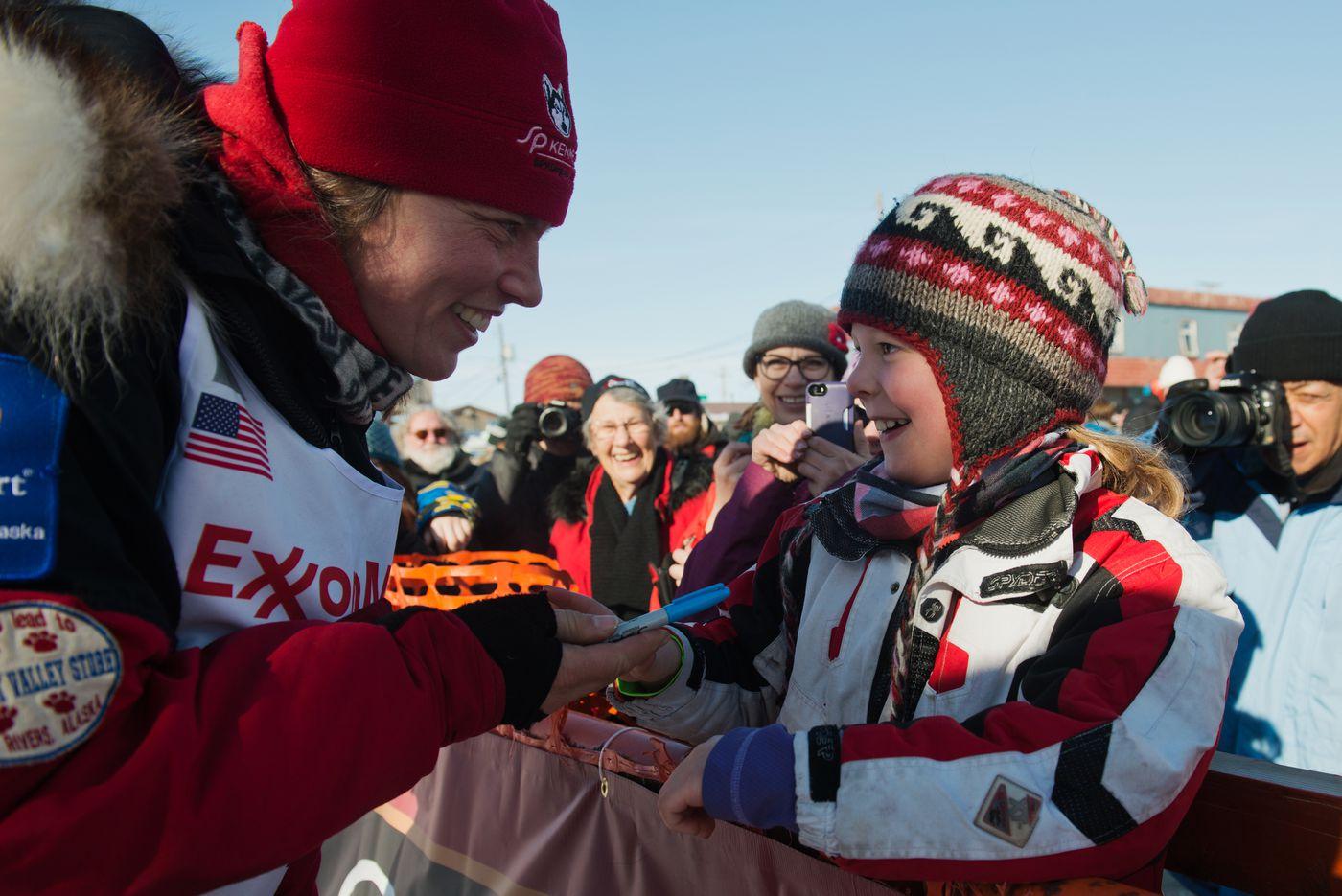Aliy Zirkle talks with a fan in Nome on Wednesday, March 18, 2015. (Marc Lester / ADN archive)