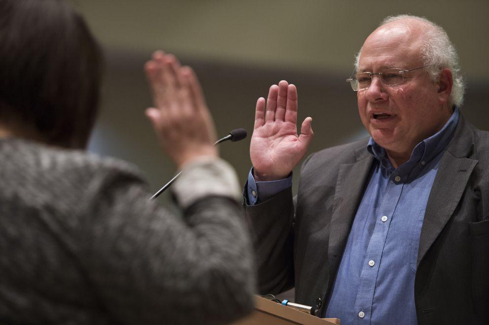 Ira Perman is sworn inTuesday. (Marc Lester / ADN)