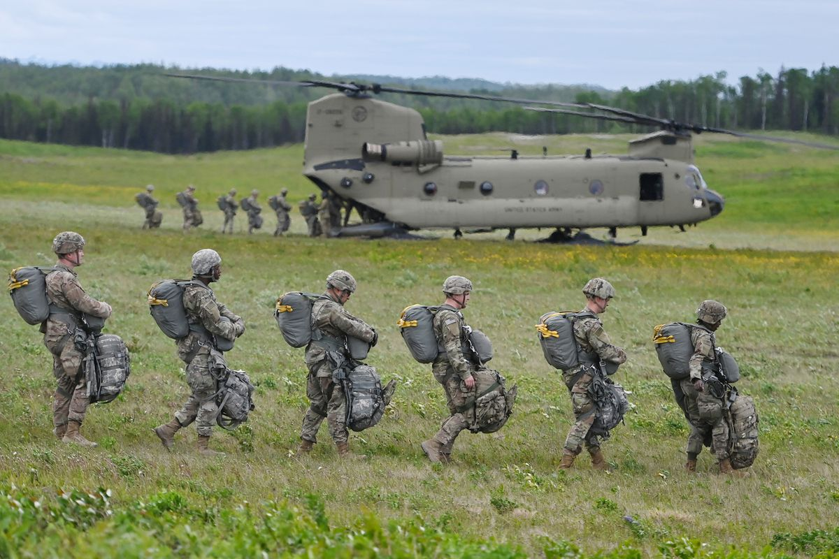 Paratroopers from the 4th Infantry Brigade Combat Team (Airborne), 25th Infantry Division, board CH-47 Chinook helicopters during airborne operations at Malemute Drop Zone on JBER on Tuesday, June 8, 2021. (Bill Roth / ADN)