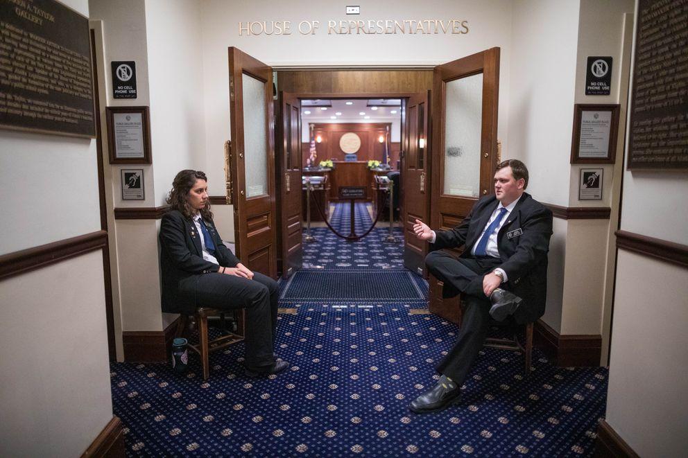 House pages Olivia Sasser, left, and Hunter Lottsfeldt wait for the House to reconvene Thursday, Jan. 17, 2019. (Loren Holmes / ADN)