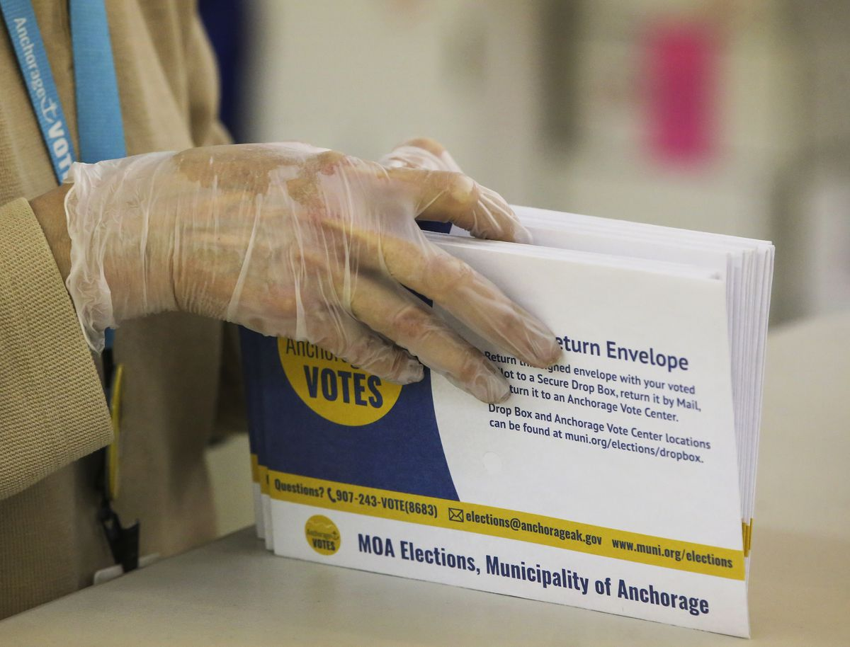 An election worker processes election ballot envelopes at the municipal Election Center in Anchorage on Wednesday, May 12, 2021. (Emily Mesner / ADN)