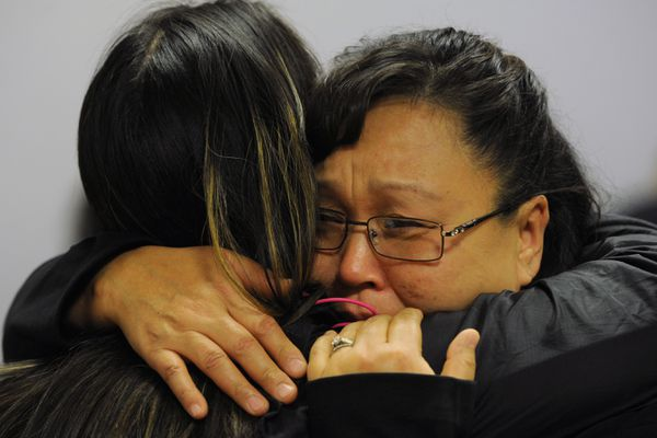 Rena Sapp, right, sister of alleged murder victim Veronica Abouchuck is embraced by Joanne Sakar as they attended the arraignment of Brian Steven Smith on Monday, Oct. 21, 2019, who has been charged with first-degree murder in the shooting death of the 52-year-old homeless woman. (Bill Roth / ADN)