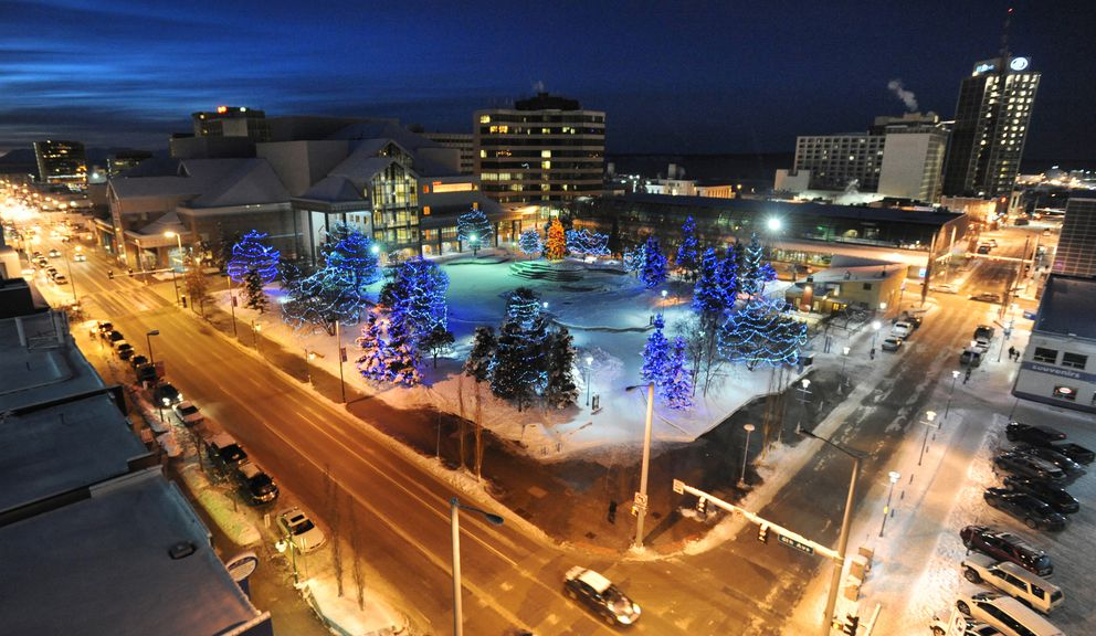 Town Square Park after sunset on Sunday, Dec. 23, 2018, as the Christmas tree lights cast a warm glow at dusk. (Bill Roth / ADN)