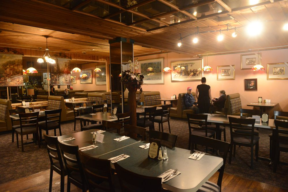 As Fiori d'Italia restaurant opens for dinner service the first customers are seated in the dinning room in the Spenard area of Anchorage, Alaska on Thursday, Nov. 9, 2017. (Bob Hallinen / Alaska Dispatch News)