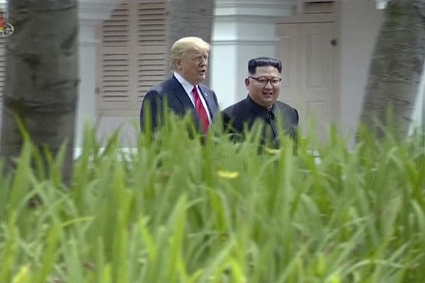 In this image made from video released by KRT on June 14, 2018, shows North Korean leader Kim Jong Un, right, walking with U.S. President Donald Trump in the garden during their summit in Singapore, June 12, 2018. Through the state-run media's edited footage of the summit that aired in their country Thursday, North Koreans are getting a new look at U.S. President Donald Trump now that his summit with leader Kim Jong Un is safely over and it's a far cry from the