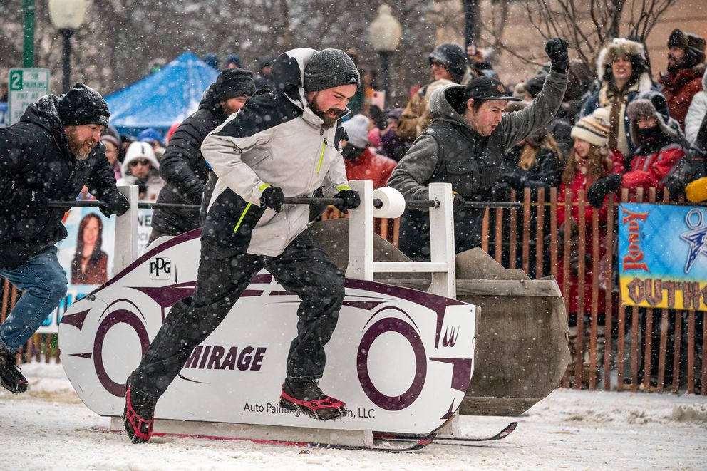 A team from Mirage Auto Painting competes in the Fur Rondezvous outhouse races on Saturday, Feb. 29, 2020 in Anchorage. (Loren Holmes / ADN)