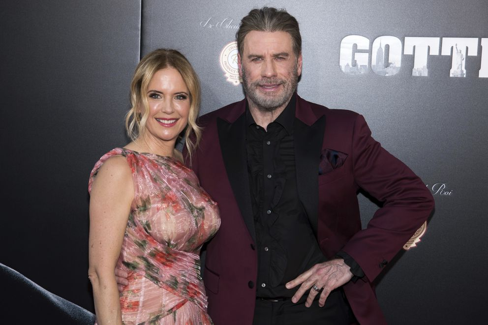 """FILE - In this June 14, 2018, file photo, Kelly Preston and John Travolta attend the premiere of 'Gotti ' at the SVA Theatre in New York. Preston, whose credits included the films """"Twins"""" and """"Jerry Maguire,"""" died Sunday, July 12, 2020, her husband Travolta said. She was 57. (Photo by Charles Sykes/Invision/AP, File)"""