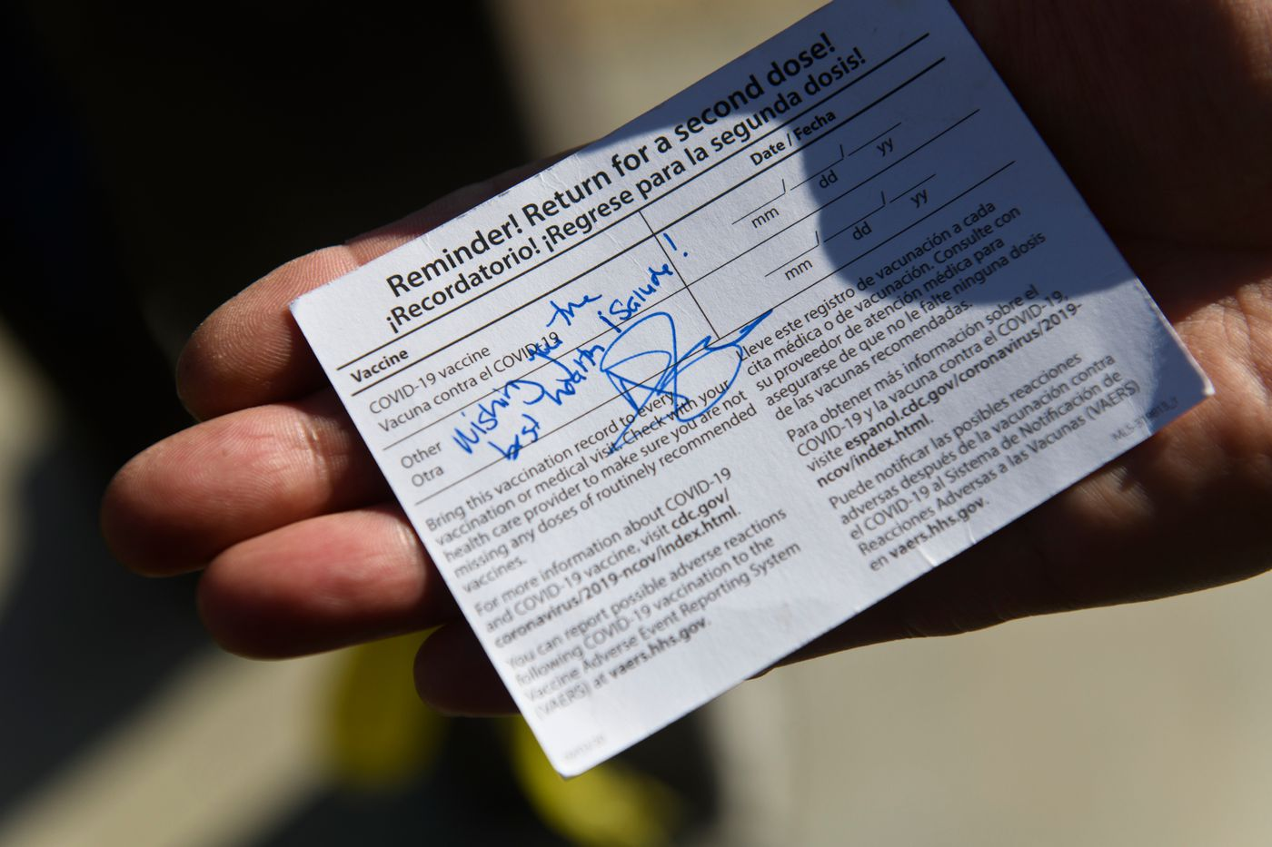 Trenton Yates, of Clam Gulch, got his COVID-19 vaccine card autographed by Anne Zink in Soldotna. (Marc Lester / ADN)