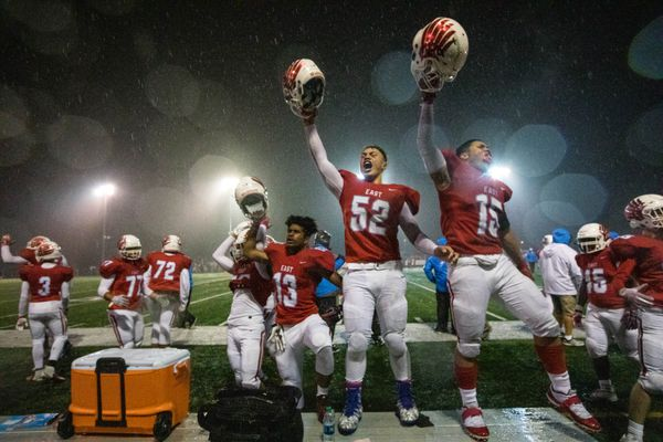 East players celebrate winning the state division 1 high school football championship Friday, Oct. 19, 2018 at the Anchorage Football Stadium. (Loren Holmes / ADN)
