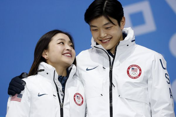Medals Ceremony - Figure Skating - Pyeongchang 2018 Winter Olympics - Ice Dance free dance - Medals Plaza - Pyeongchang, South Korea - February 20, 2018 - Bronze medalists Maia Shibutani and Alex Shibutani of the U.S. on the podium. REUTERS/Kim Hong-Ji